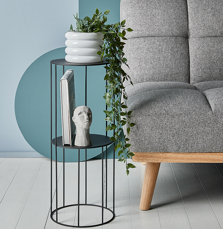 Pedestal with ornament and plant pot with artificial plant