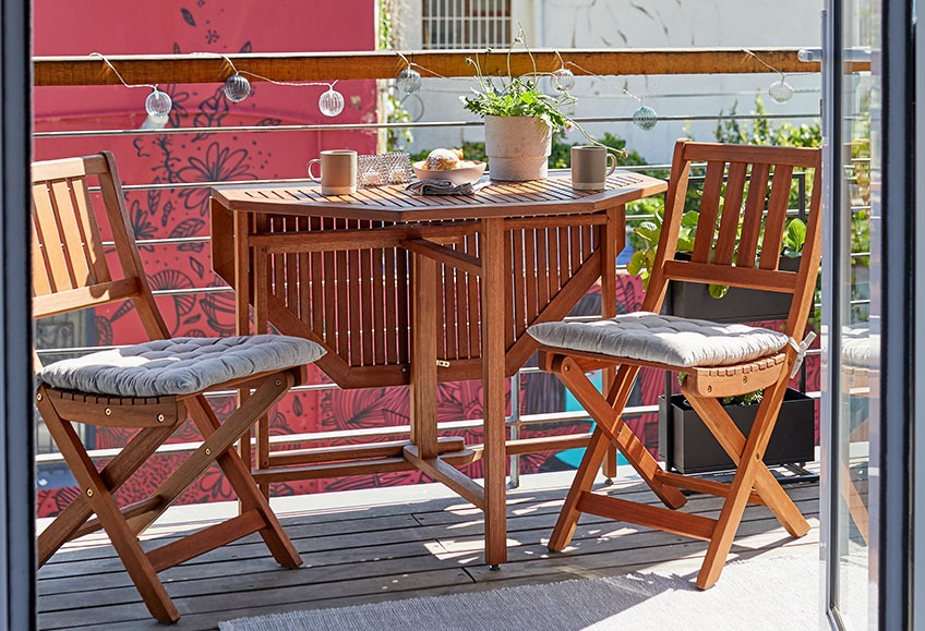 Wooden garden bistro set on balcony