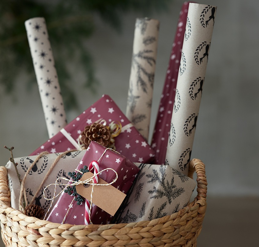 Wrapping paper and Christmas presents in a basket